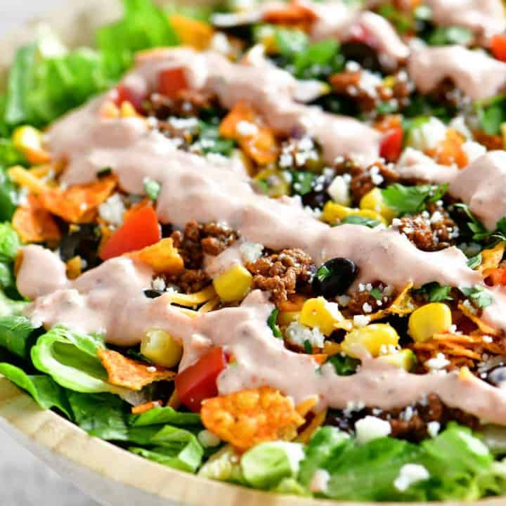 a close up photo of taco salad in a bowl