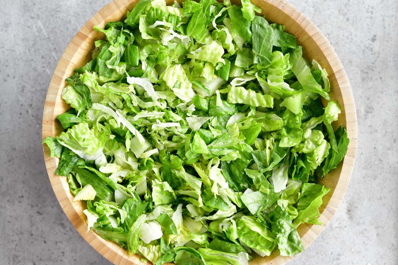add lettuce to the bowl