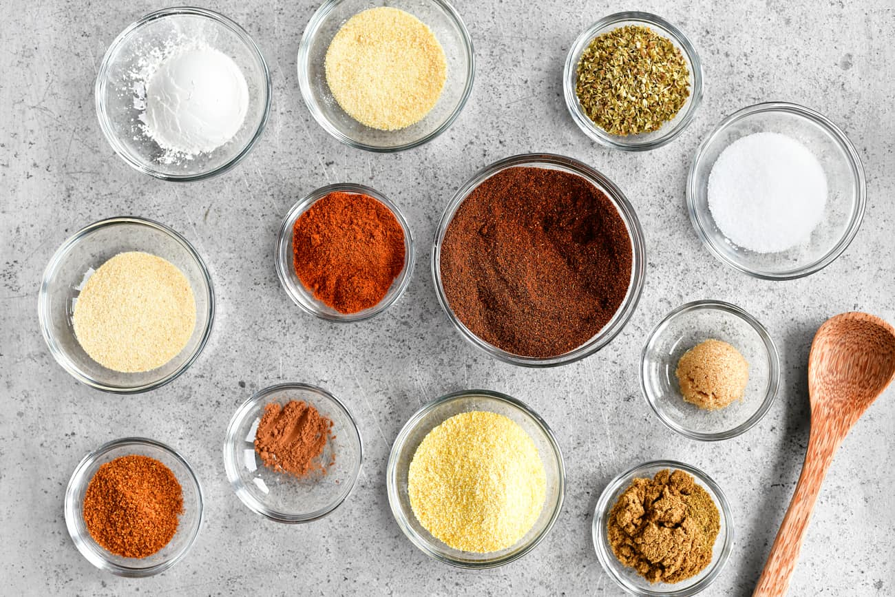 individual taco seasoning ingredients in glass prep bowls