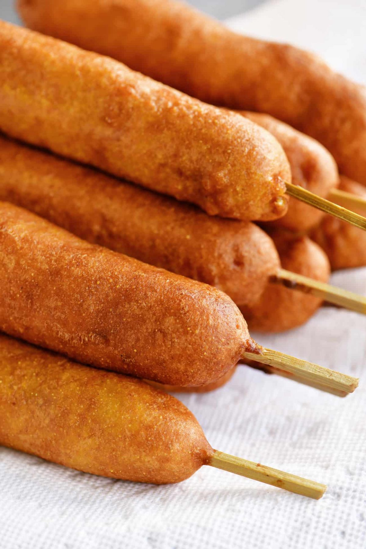 a golden stack of fried corn dogs