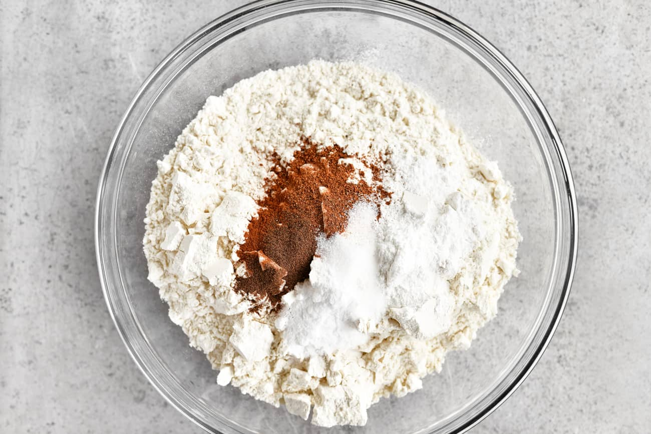 flour, cinnamon, sugar and other ingredients in a mixing bowl