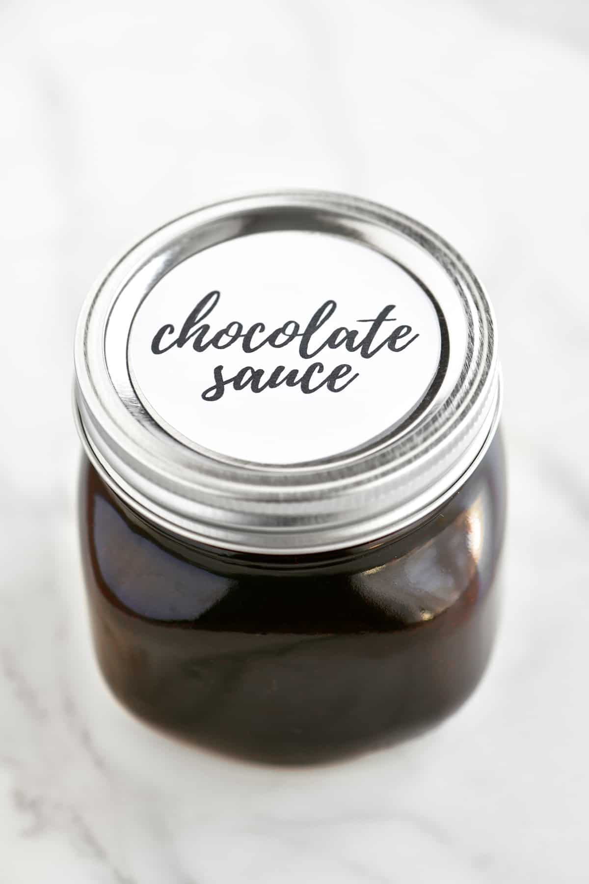 "chocolate sauce in a jar with a label that says ""chocolate sauce"""