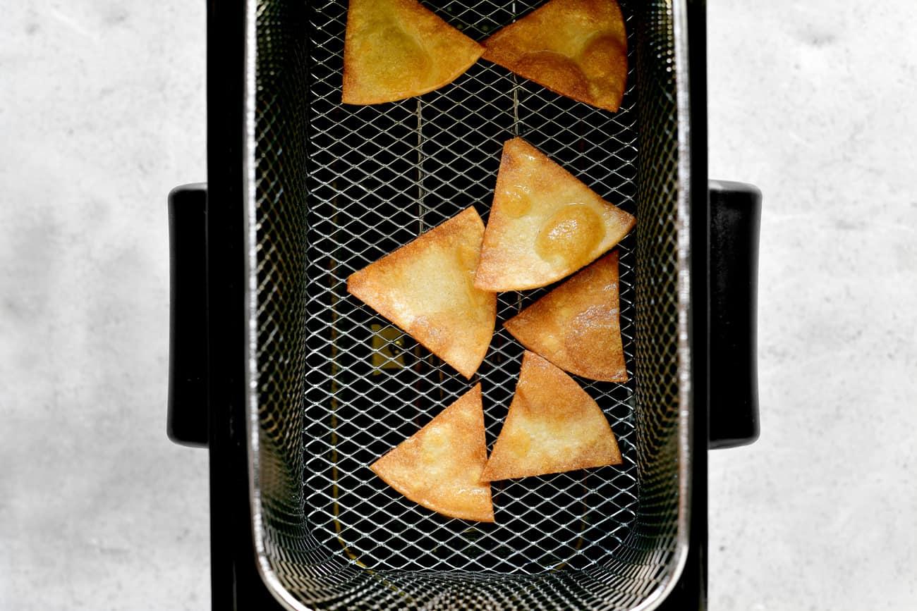 corn tortilla chips in wire fryer basket