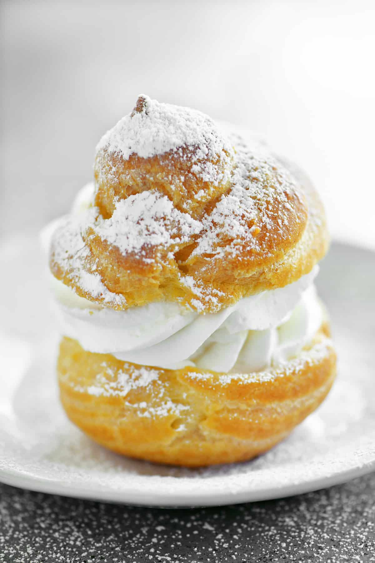 a single cream puff on a plate