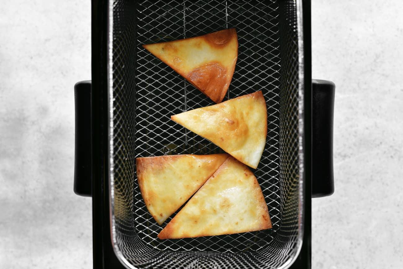 flour tortilla chips in fryer basket