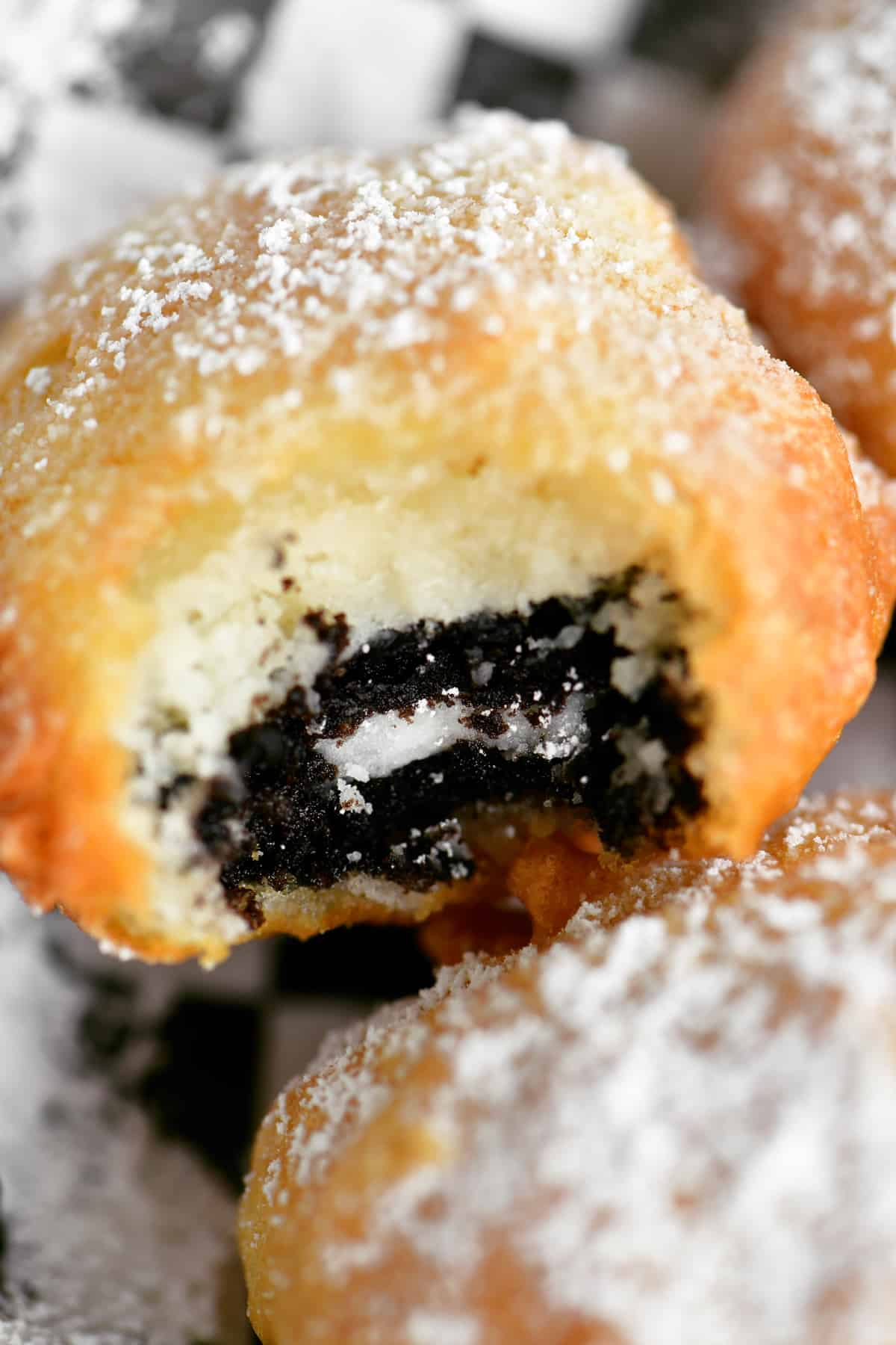 a close up image of a fried Oreo cookie with a bite out of it