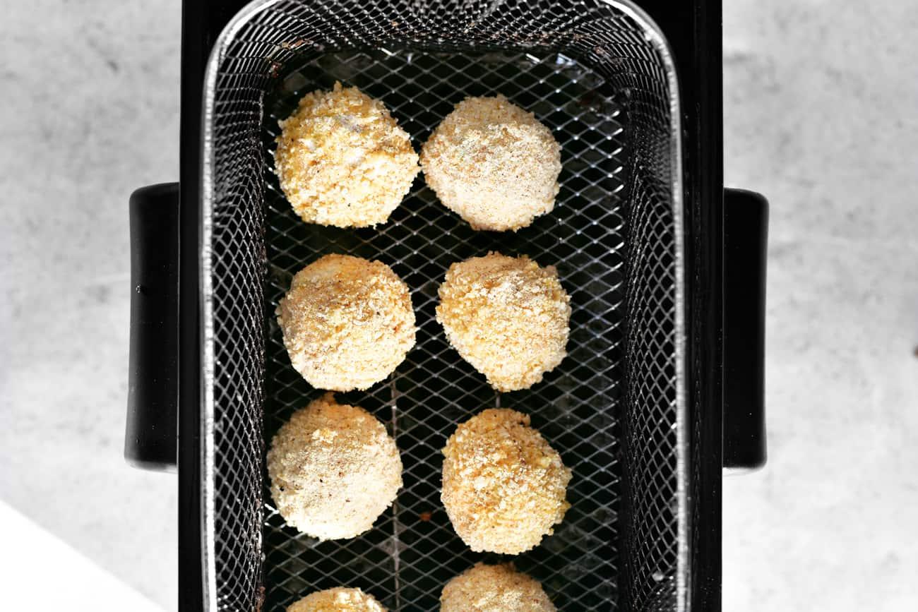 coated jalapeño popper bites in the fryer basket