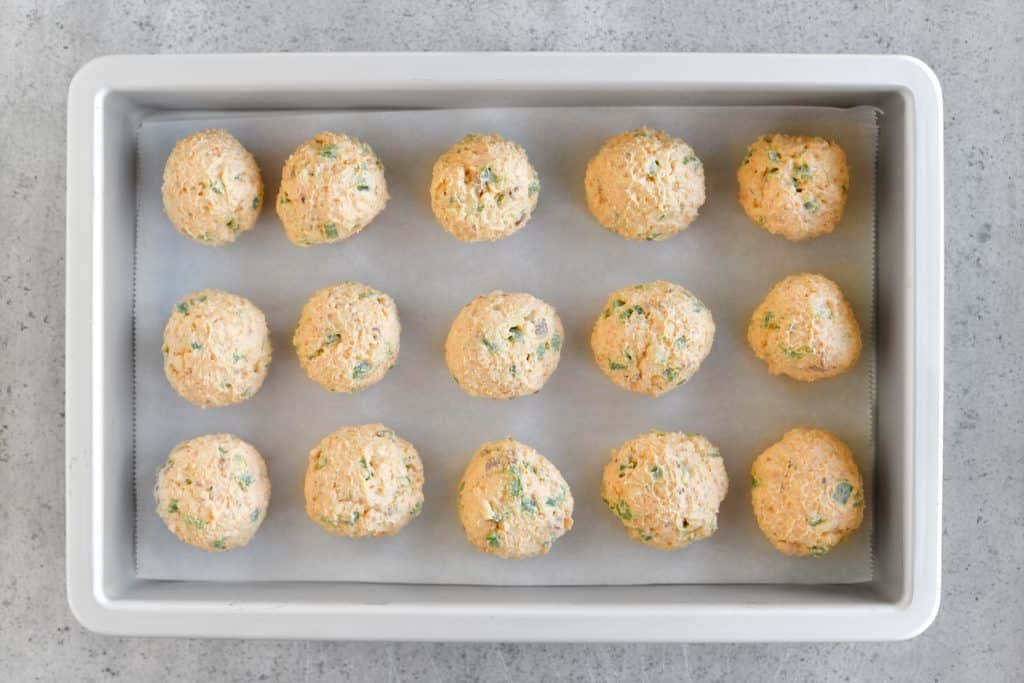 jalapeño popper bites formed into balls and placed in a pan
