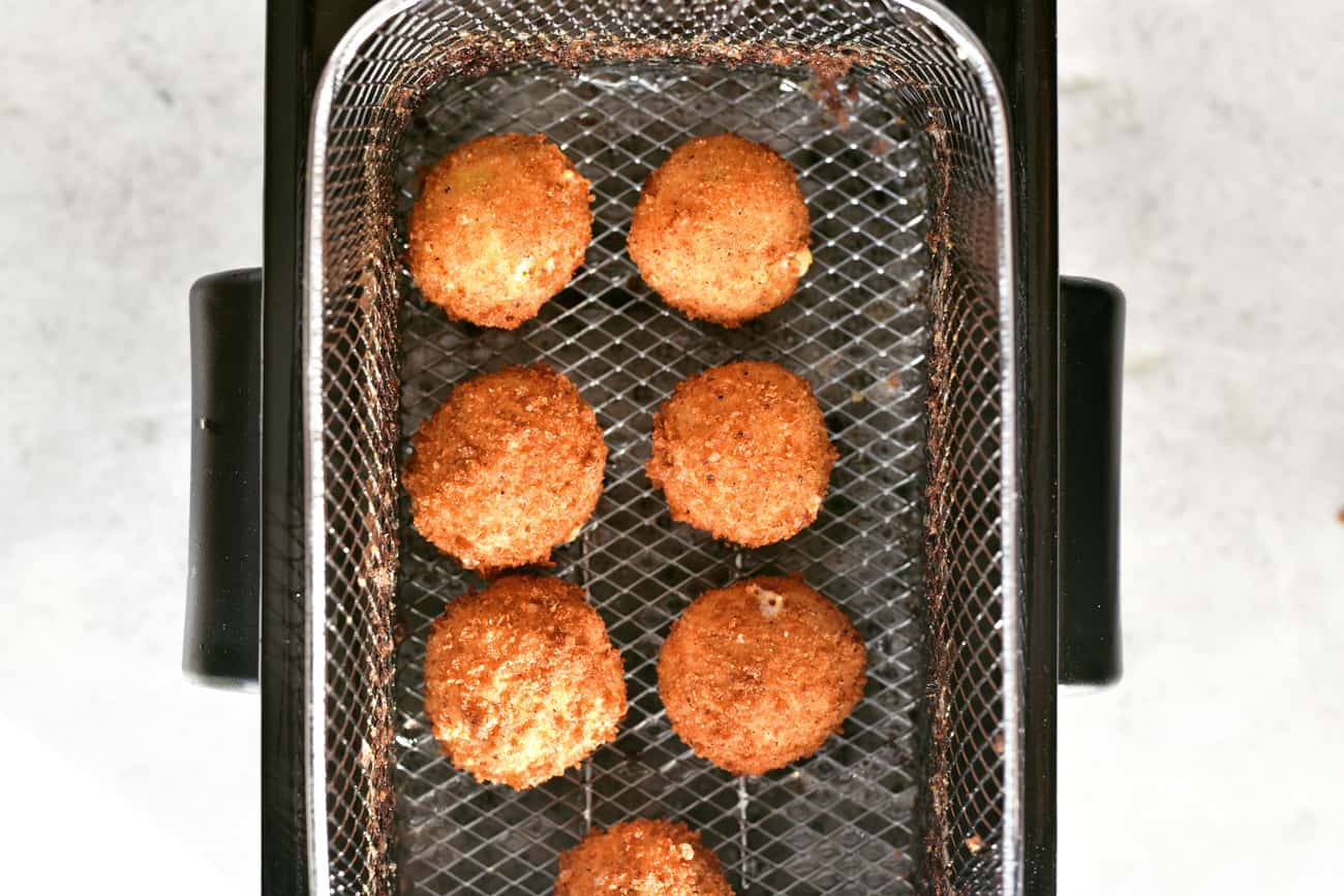 fried cheese balls in the fryer basket