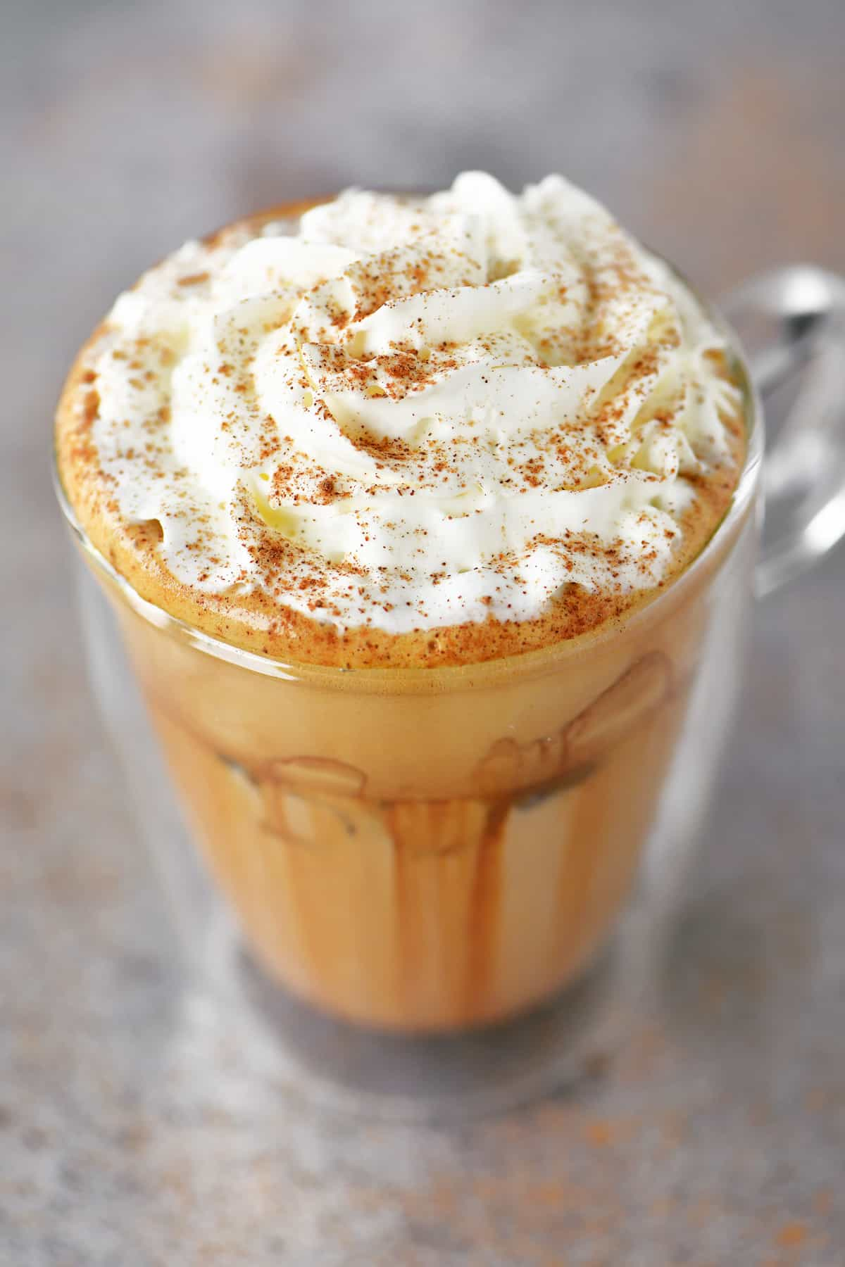 sprinkle whipped cream with pumpkin spice