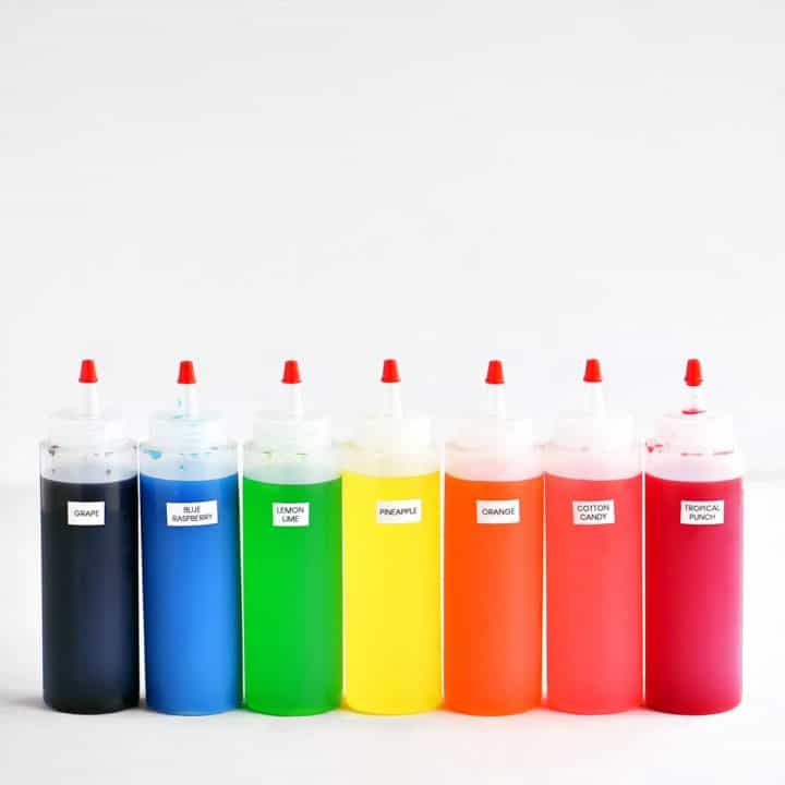 row of colorful filled squeeze bottles
