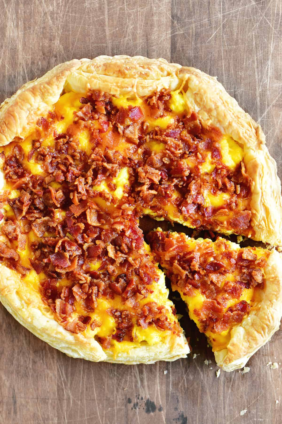 a topdown view of a bacon egg and cheese breakfast pizza