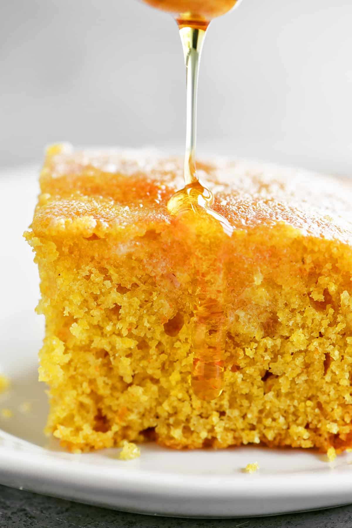drizzle honey on a piece of cornbread
