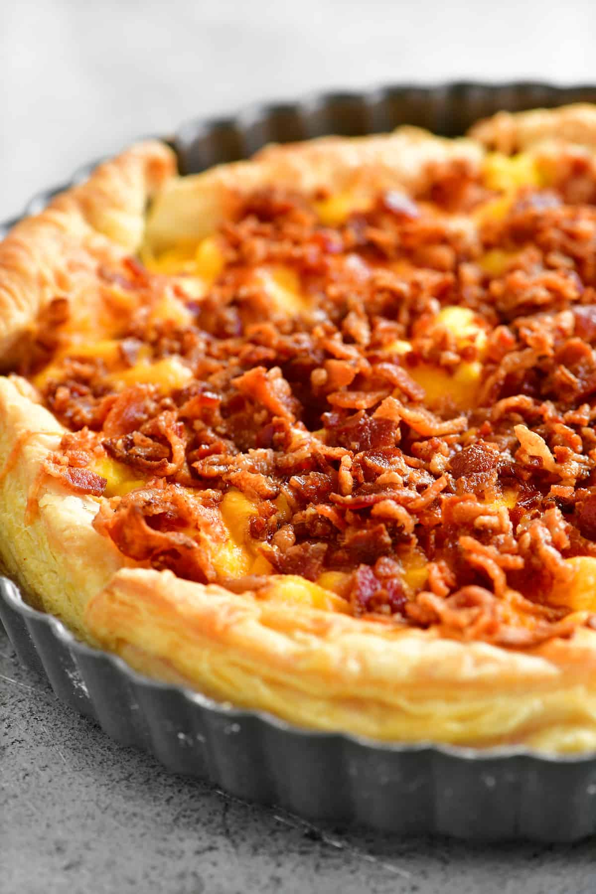 a breakfast pizza in a quiche pan