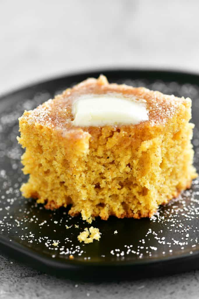 a delicious piece of cornbread with a bite out of it