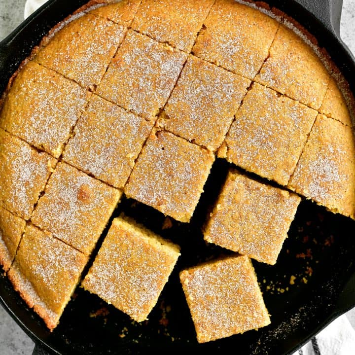 a topdown shot of sliced cornbread in the pan
