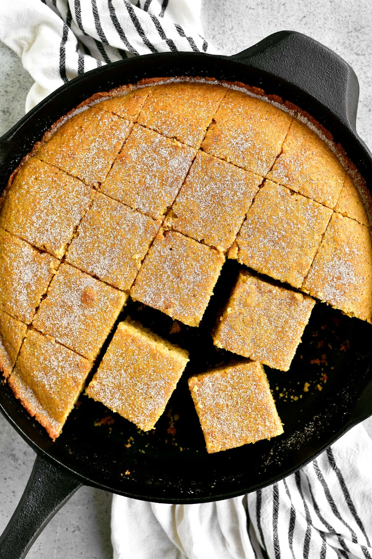 a topdown shot of sliced sweet cornbread in the pan