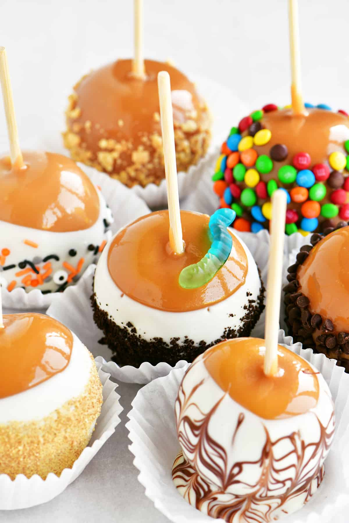 a close-up of candy coated caramel apples