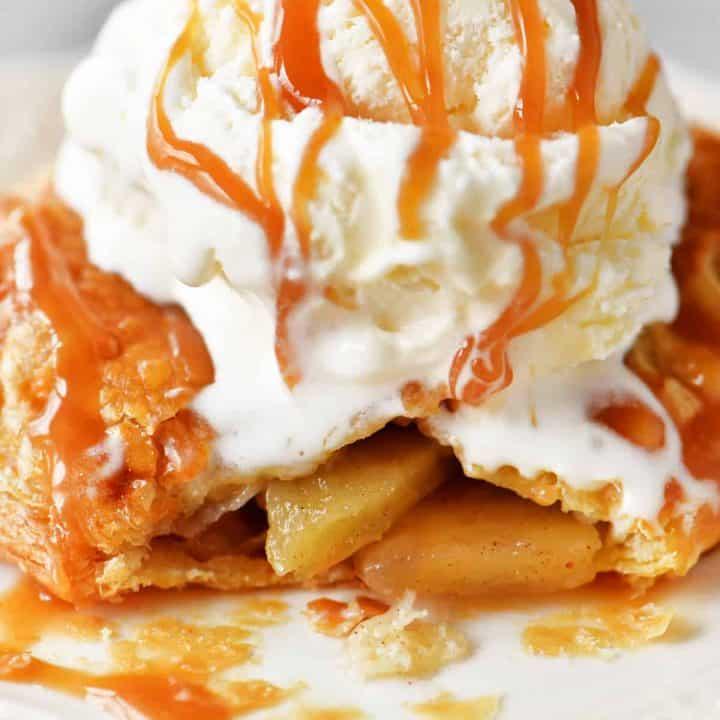 melting vanilla ice cream on a hot tasty caramel applepastry