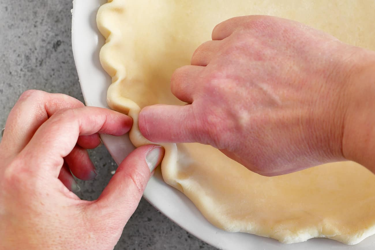 fingers fluting a pie crust