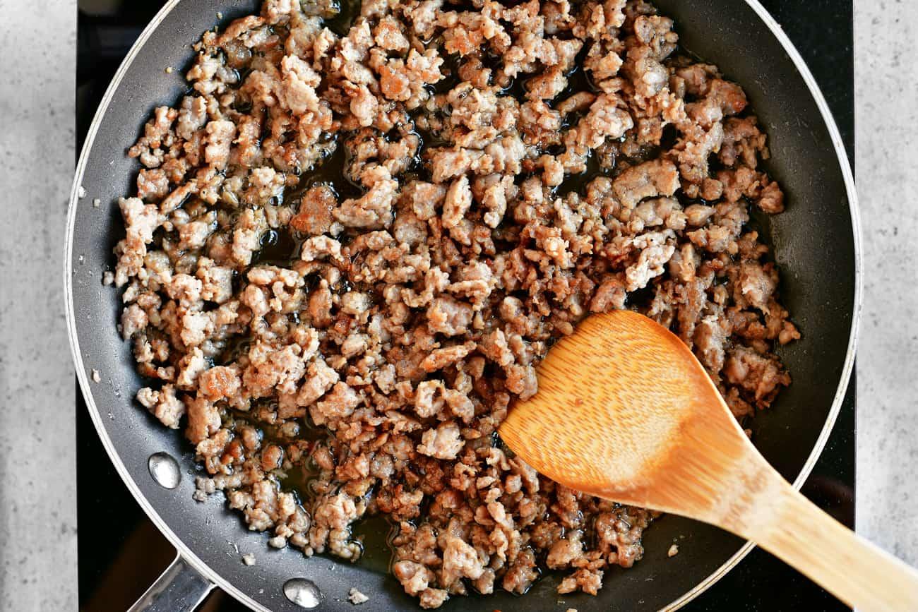 frying meat in a frying pan