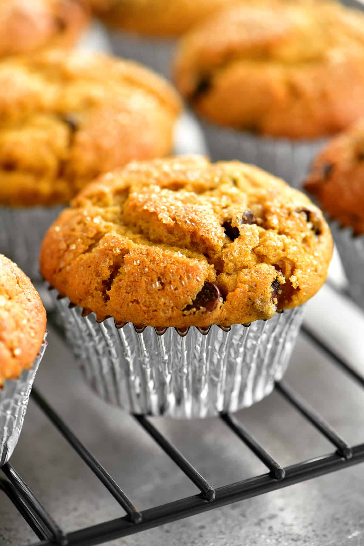 a closeup of pumpkin muffins on a cooling rack
