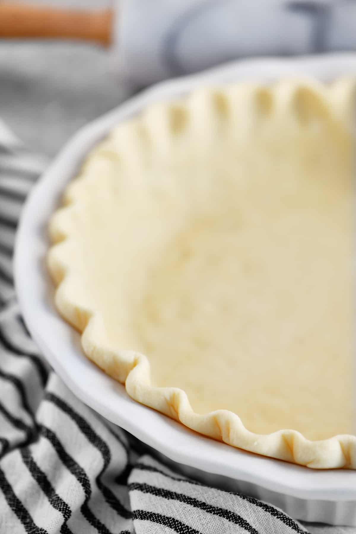 fluted pie crust dough in pan