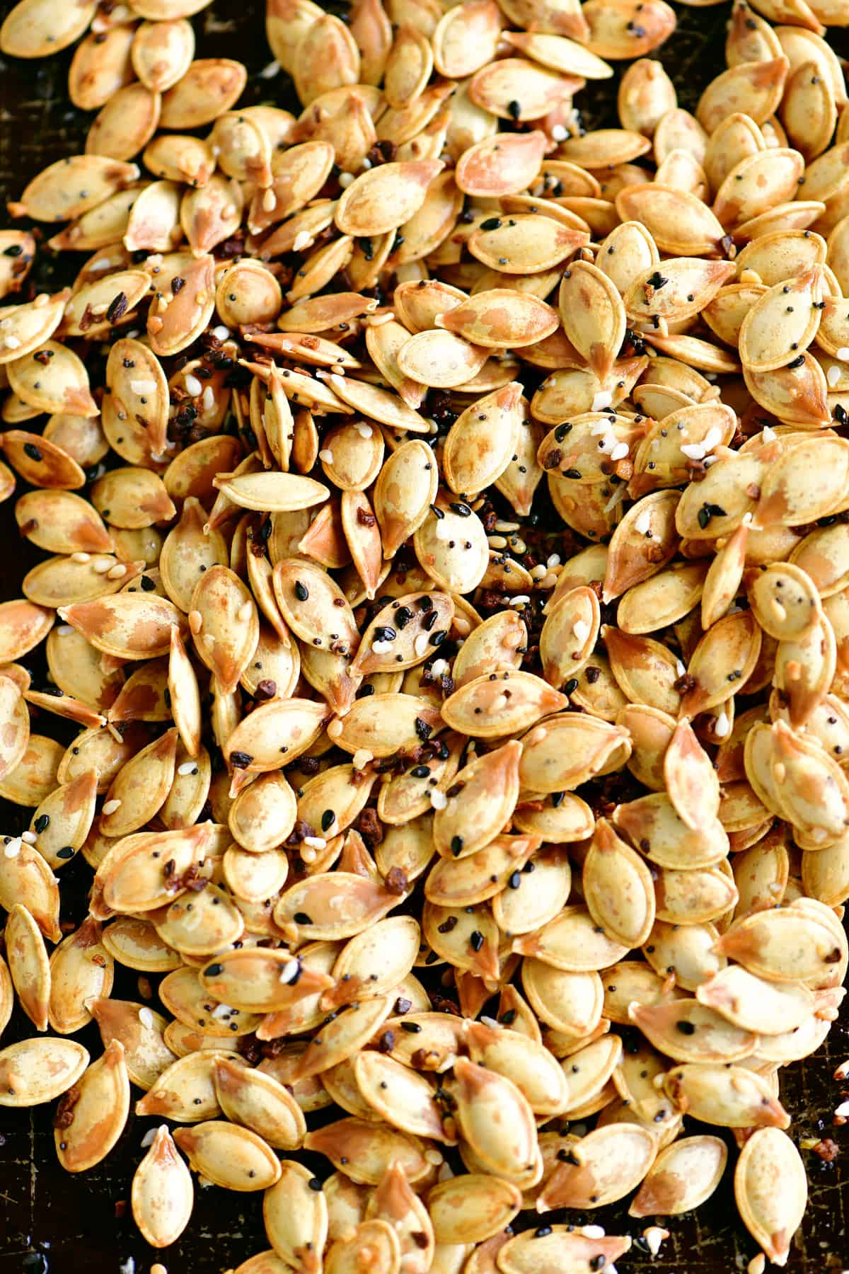 a topdown close-up view of the pumpkin seeds on a pan