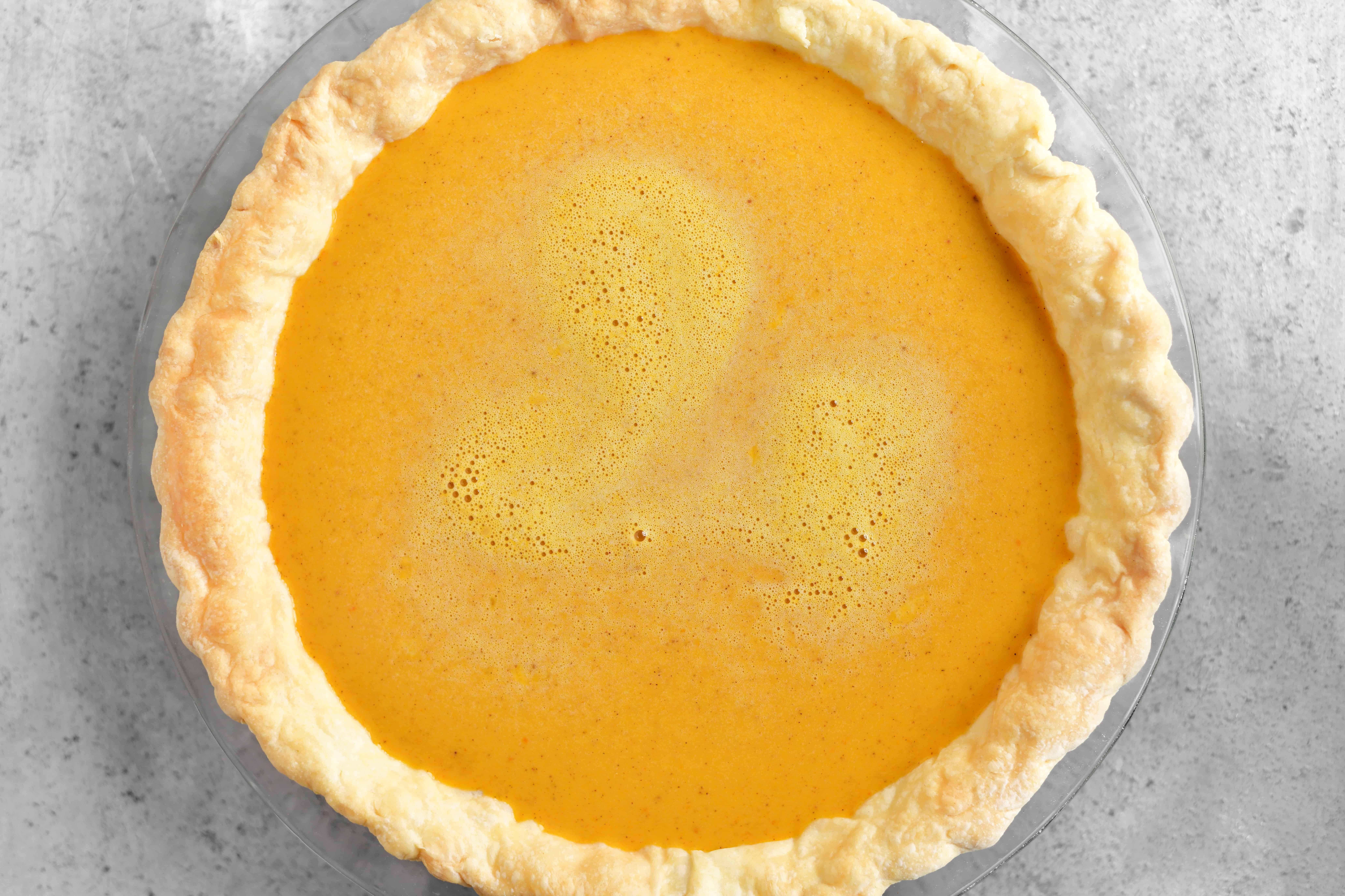 adding the filling to the pie crust