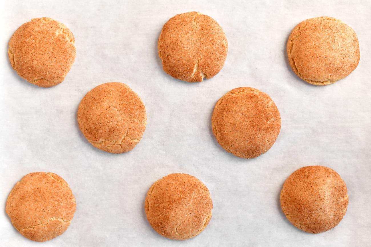golden snickerdoodles on a cookie sheet