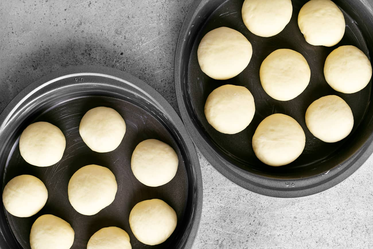 dough balls in the baking pans