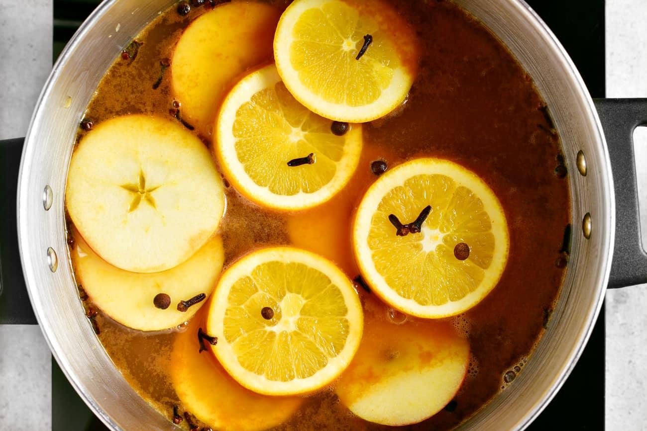 apple and orange slices simmering in hot apple cider