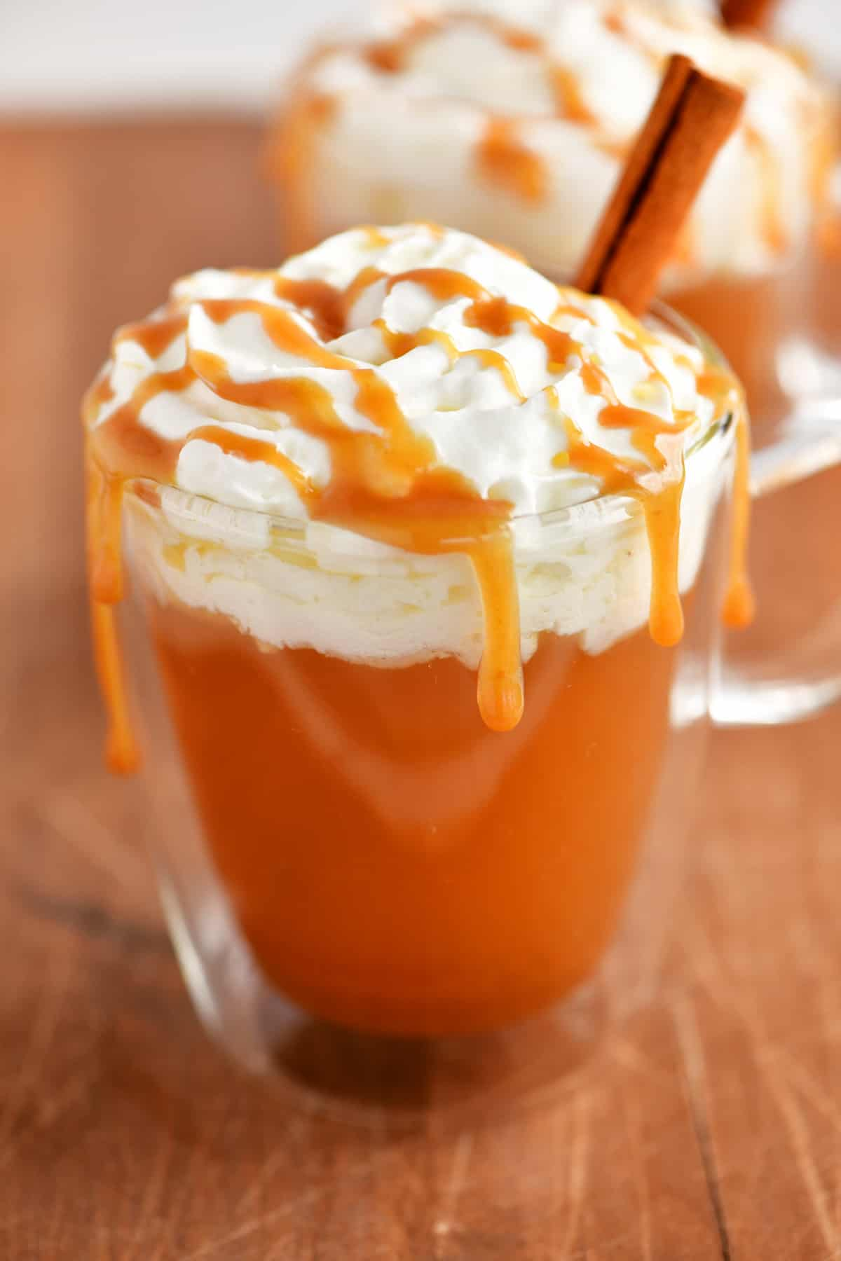 whipped cream and caramel on hot apple cider