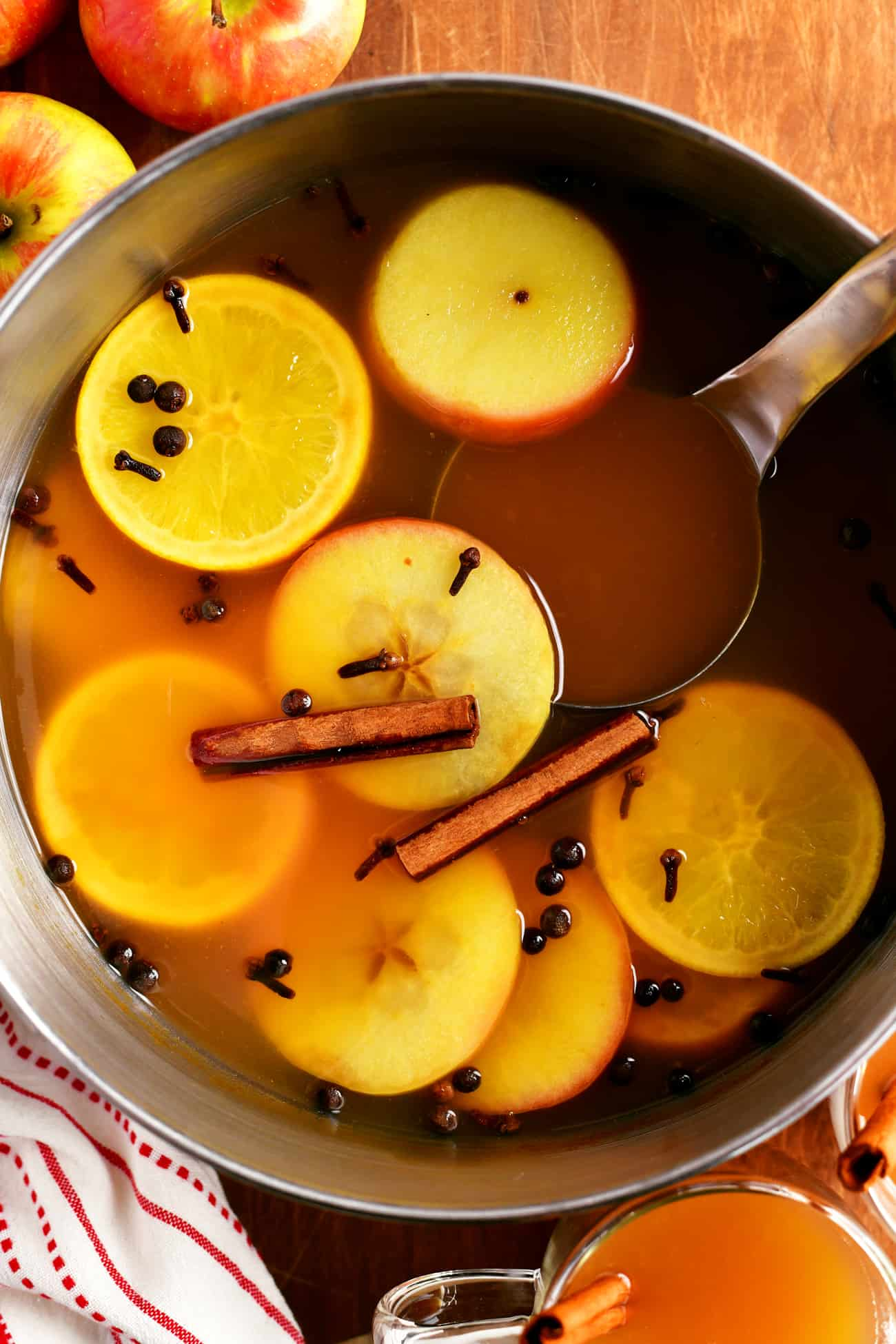 pot of mulled cider with a ladle