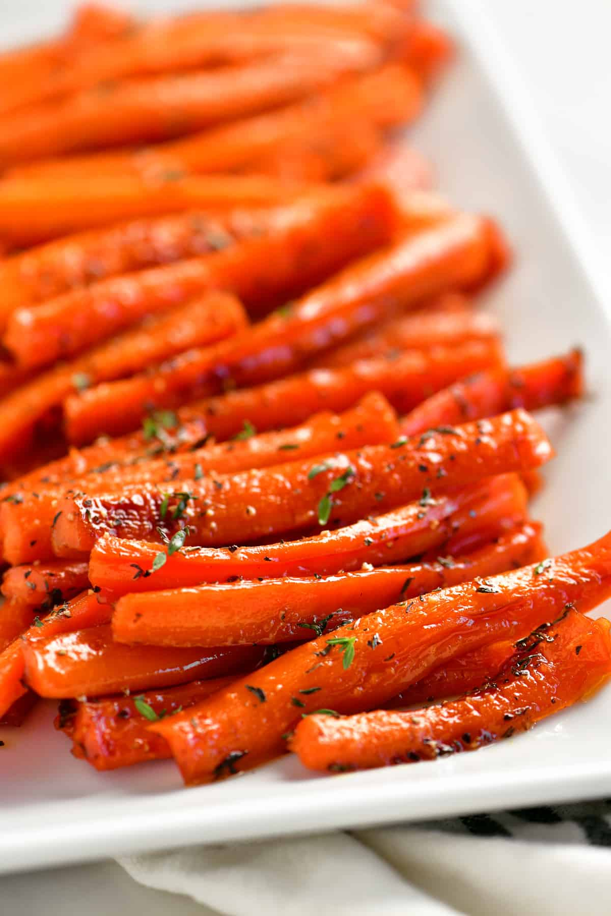 a close-up of the seasonings on the carrots