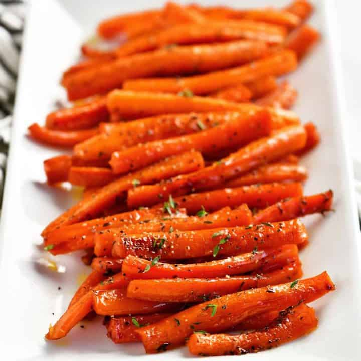 carrots lined up on a serving tray