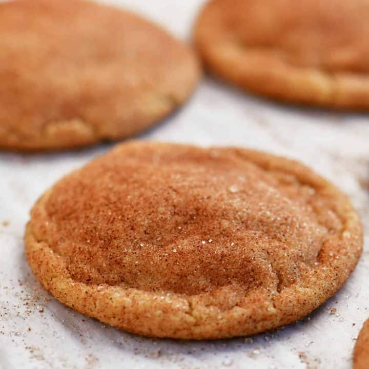baked snickerdoodles on parchment paper