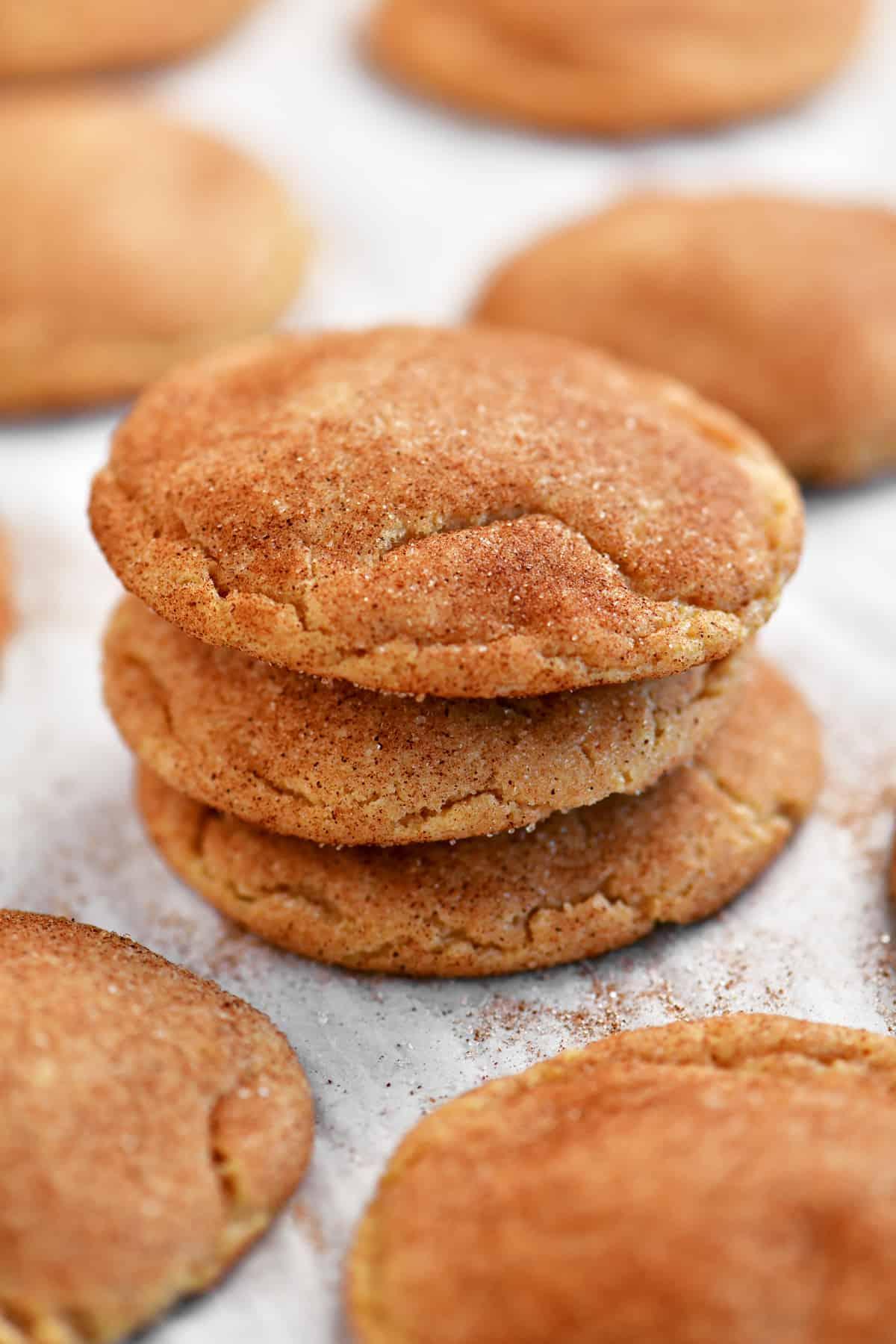 golden snickerdoodle cookies in a stack