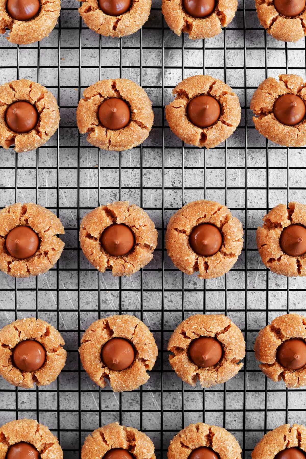 baked peanut butter blossoms on the cooling rack