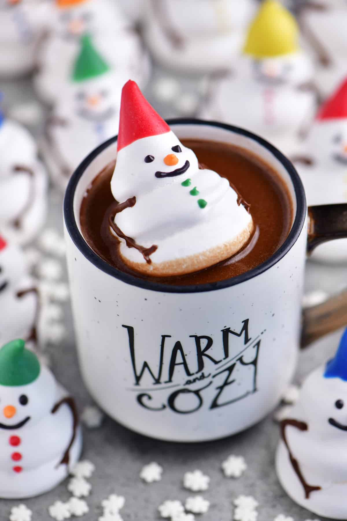 a topdoiwn view of a meringue snowman cookie in a cup of hot cocoa