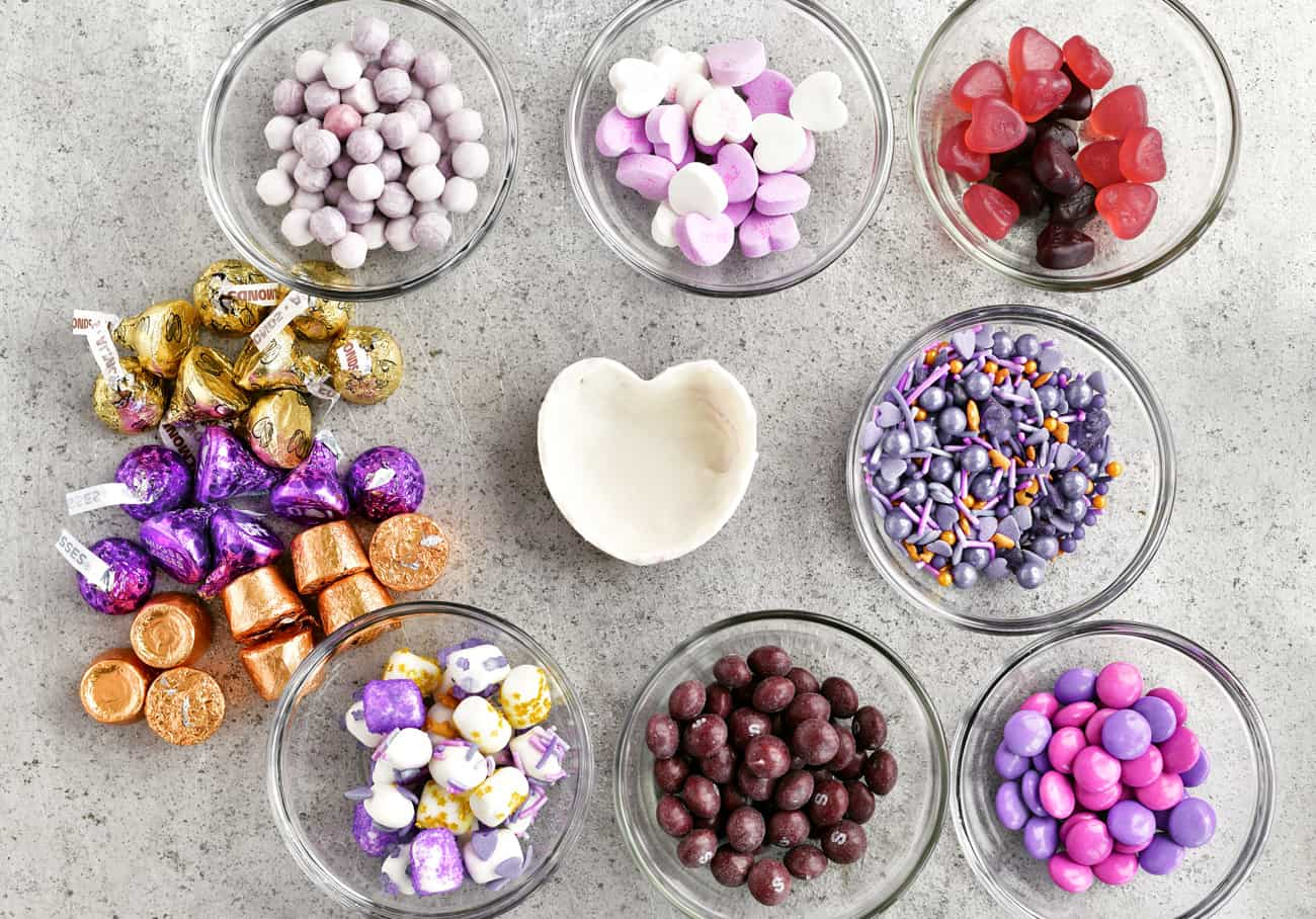 purple and gold candies in bowls