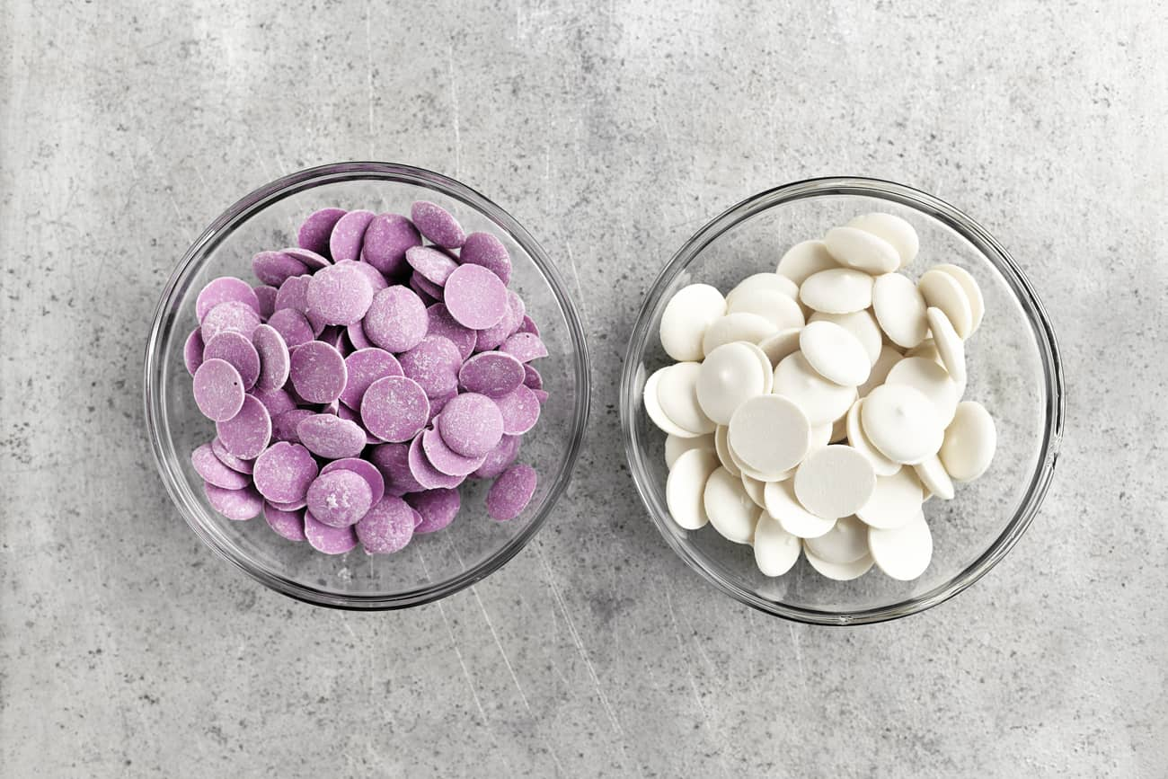 purple and white candy wafers in bowls