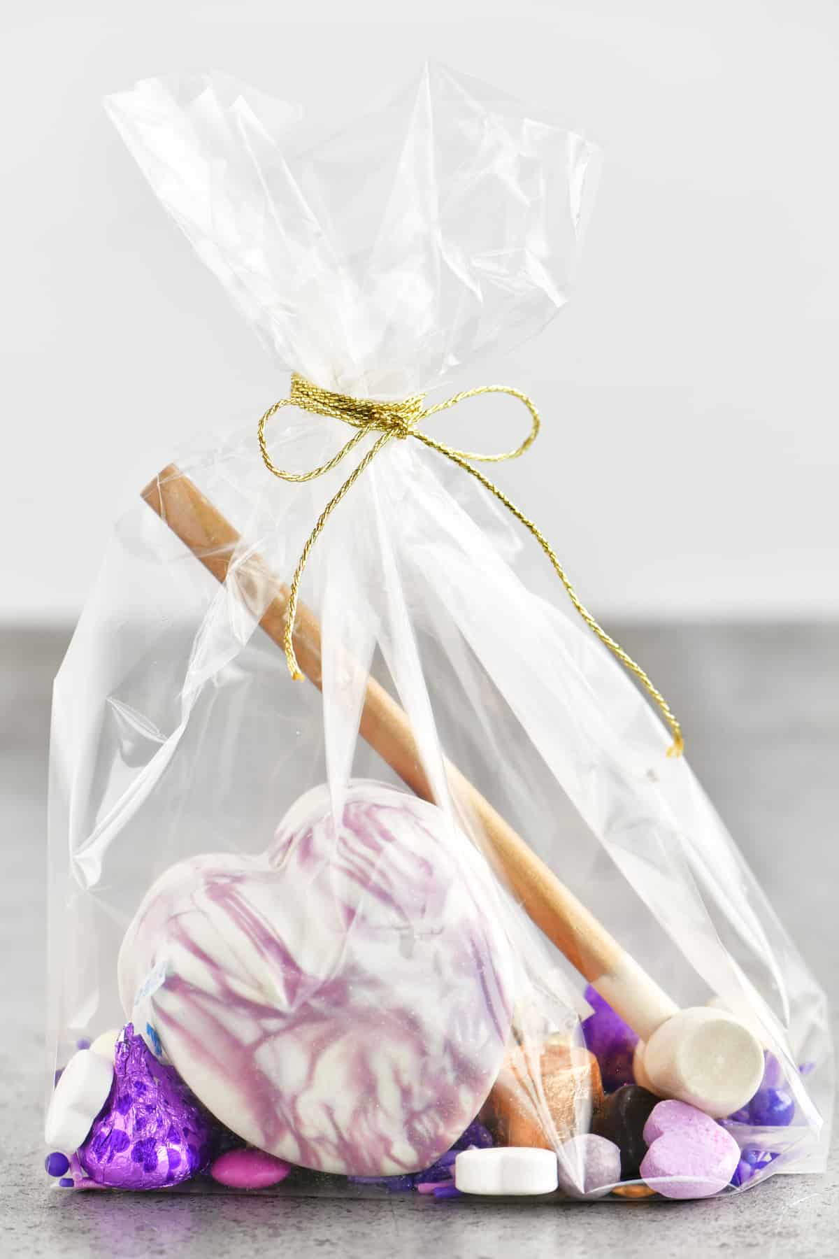 purple and white swirled breakable chocolate heart in a gift bag