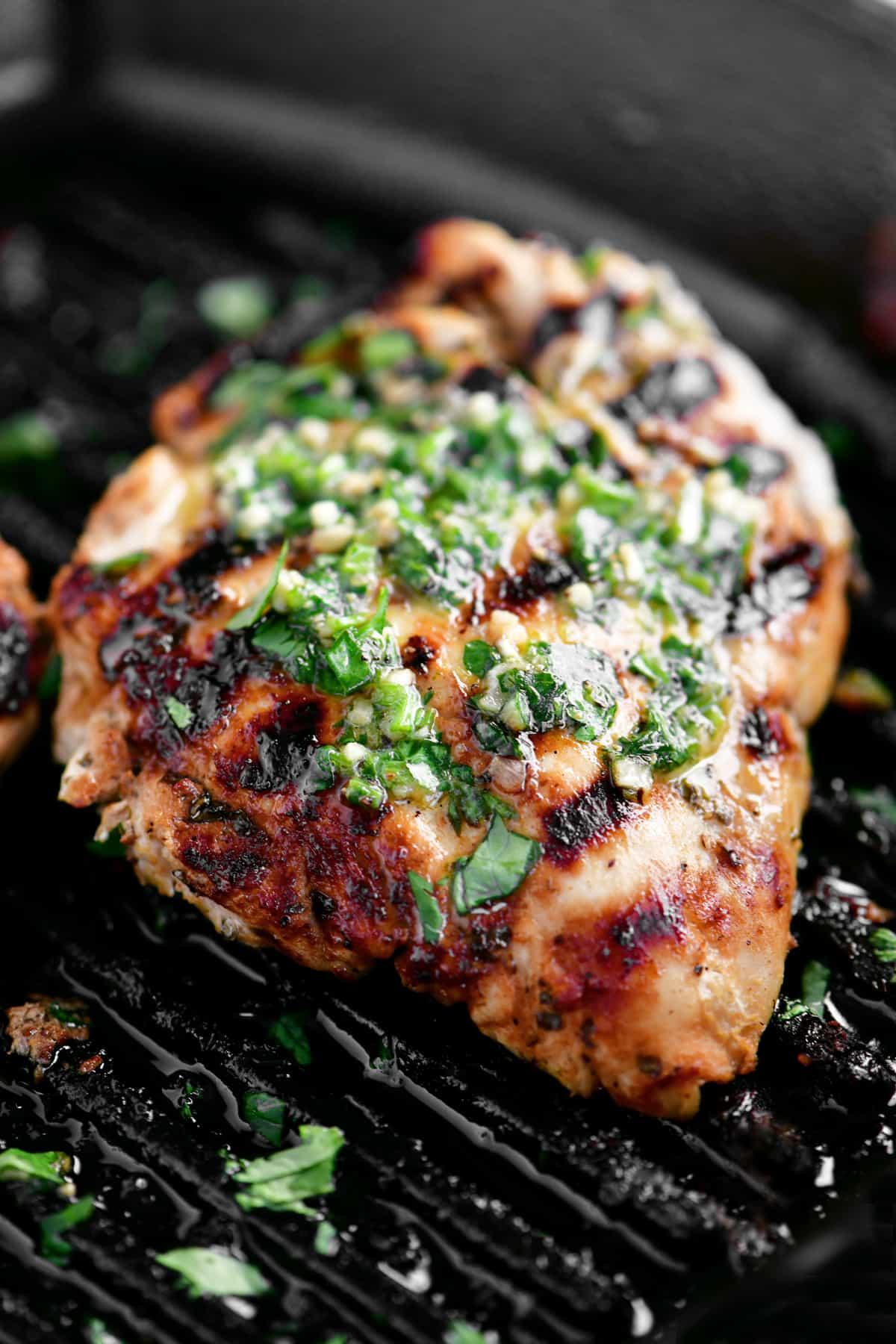 a seasoned chicken breast in a pan