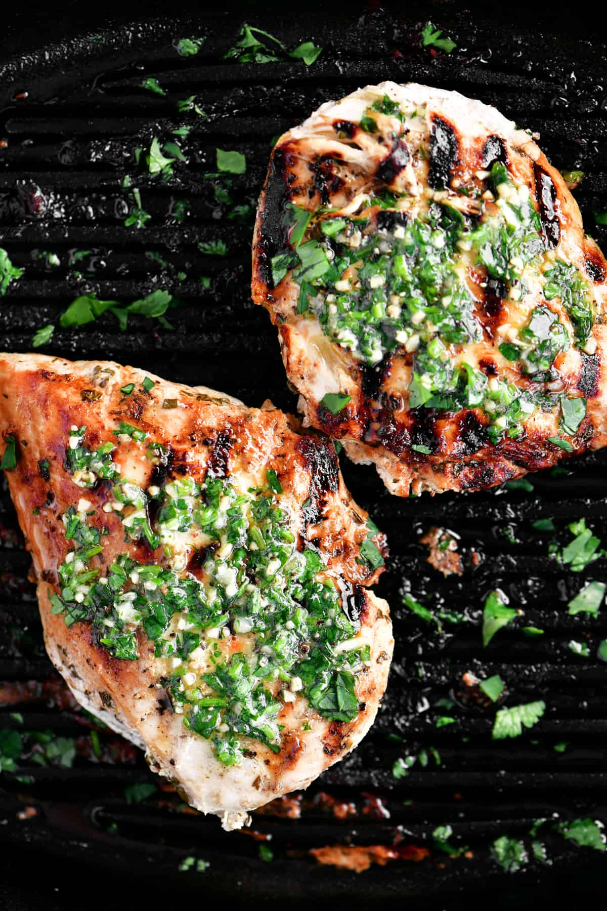 two cilantro lime chicken breasts in a black cast iron pan