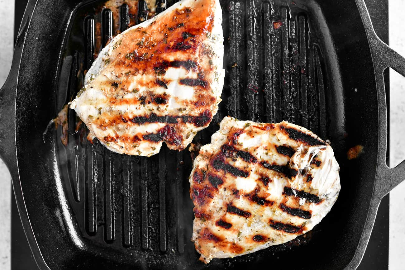 cooked chicken breasts in a cast iron pan
