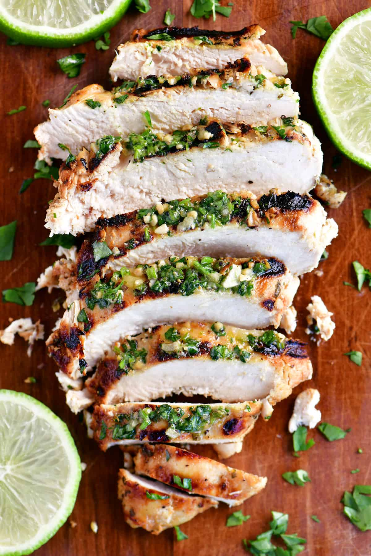 sliced cilantro lime chicken on a cutting board