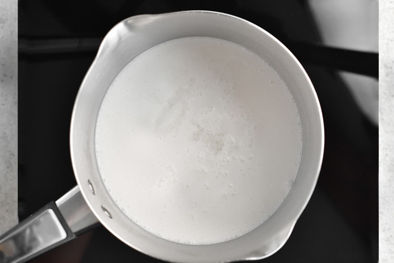 simmering water and coconut milk in a pot