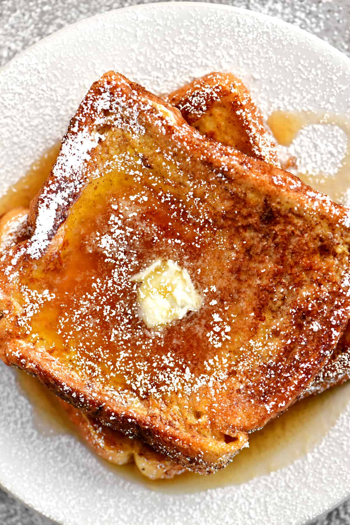 a topdown view of syrup and butter on french toast