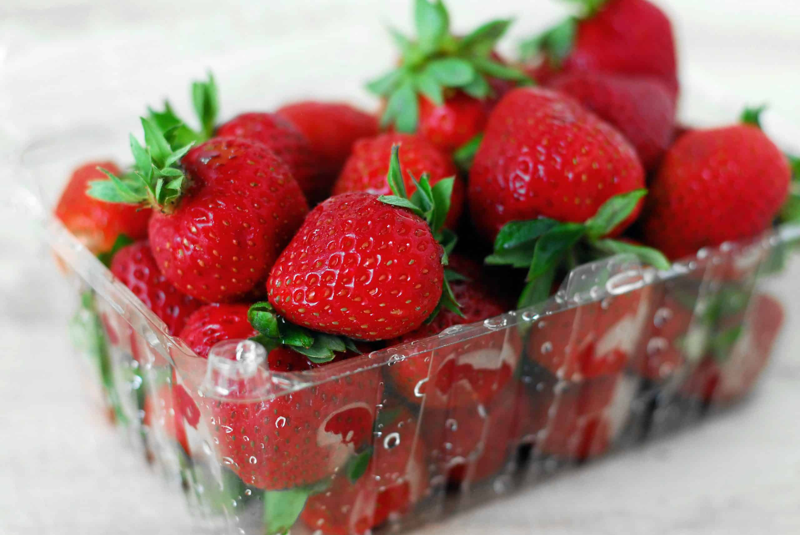 fresh strawberries in a plastic crate